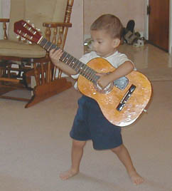 He holds the guitar really well especially for a 2 year old!